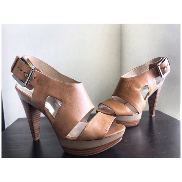 946281840760 M 5c858f69a5d7c67a310fddca. Other Shoes you may like. Michael Kors sia leather  platform sandal